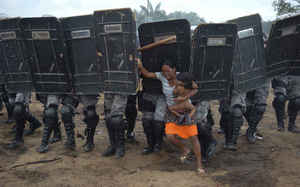 Woman tries to stop forced eviction of her people, Manaus, Brazil, March 10